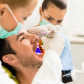 Male patient at the dentist.